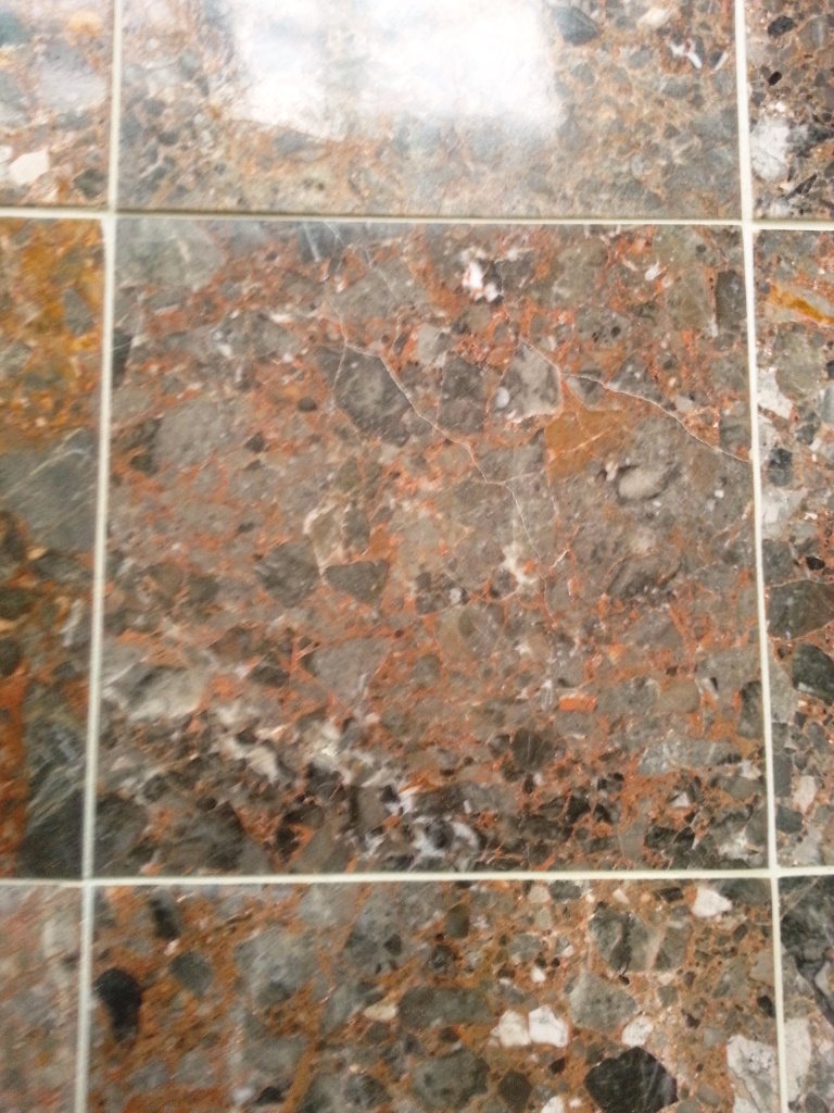 Terrazzo tiles etched with vinegar after restoration