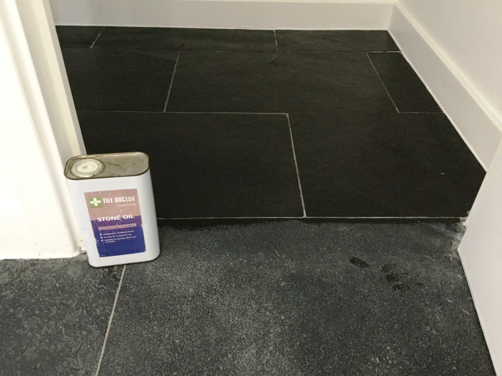 Black limestone floor Wixams applying stone oil