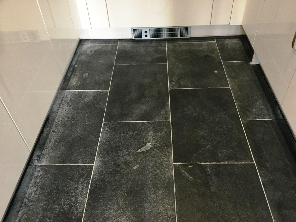 Black limestone floor Wixams before cleaning